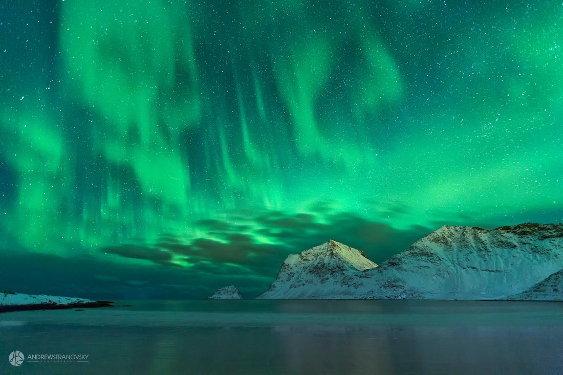 Northern Lights over Haukland Beach in the Lofoten Islands, Norway
