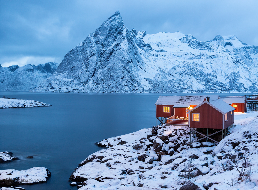 Hamnoy, Norway: A view of the Eliassen Rorbuer cabins during blue hour in the Lofoten Islands in Norway.